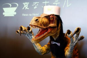"A receptionist dinosaur robot performs at the new robot hotel, aptly called Henn na Hotel or Weird Hotel, in Sasebo, southwestern Japan, Wednesday, July 15, 2015. From the receptionist that does the check-in and check-out to the porter that's a stand-on-wheels taking luggage up to the room, the hotel, that is run as part of Huis Ten Bosch amusement park, is ""manned"" almost totally by robots to save labor costs. (AP Photo/Shizuo Kambayashi)"
